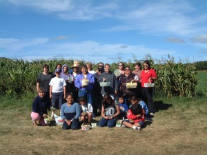 A crew with the Gleaning Project after a day of harvesting beans
